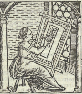 A woman embroiders at a large frame